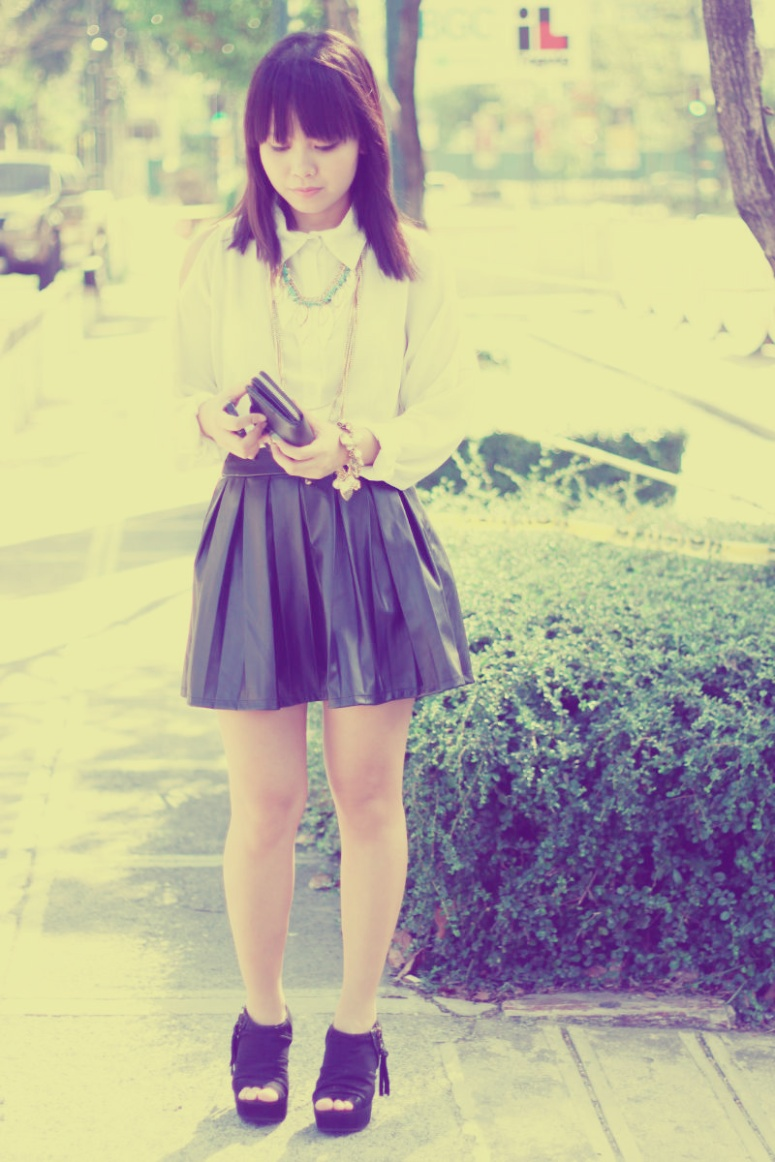 white shirt leather skirt